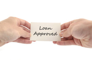 loan approved card two hands