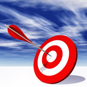 Conceptual red dart target board with arrow in the center on clouds