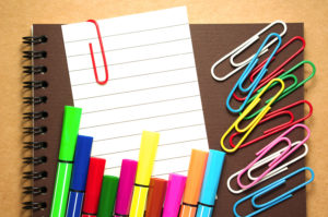Note paper with colorful marker and clips